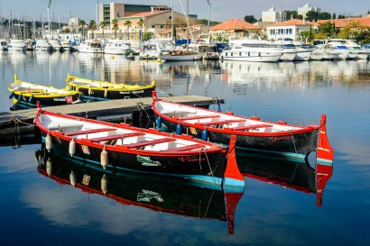 Four boats in Martigues, France on a calm Tuesday morning.