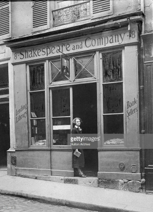 American publisher Sylvia Beach (1887 - 1912) stands in the doorway of her bookshop Shakespeare & Company, Paris, France, 1920s. Famous for being run by the only person willing to publish James Joyce's Ulysses in the English language, Beach's store was a haven for American ex-patriates during the 1920s and 1930s. (Photo by Pictorial Parade/Getty Images)